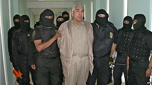 Rafael Caro Quintero in handcuffs with police