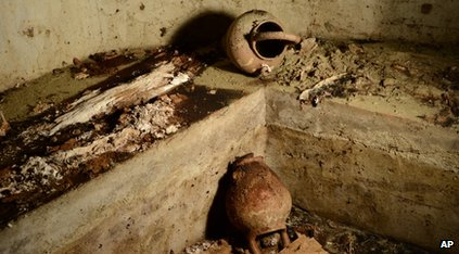 Tomb with vases and bones in it