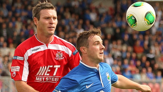 Portadown's Kevin Braniff in action against Linfield's Jamie Mulgrew