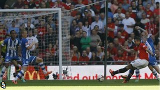 Robin van Persie scores Manchester United's second goal against Wigan