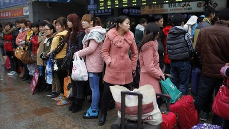 Migrant workers make their way to Shanghai railway station, the meeting point where an online employment agency arranged to pick them up to their new jobs, in Shanghai in this February 26, 2013 file photo.