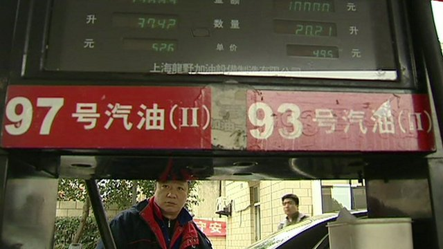 Chinese man at petrol pump