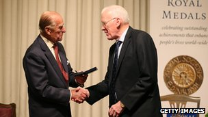 Prince Philip presents Sir Ian Wood with a Royal Medal during a medal presentation event at the Royal Society of Edinburgh on 12 August 2013 in Edinburgh