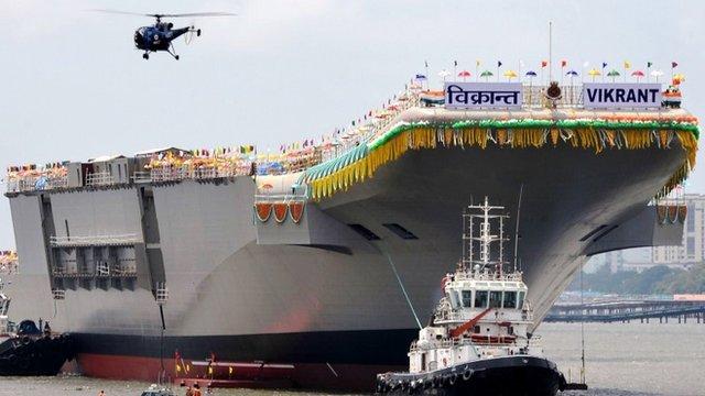 Tugboats guide INS Vikrant