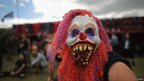 Person in mask at Bloodstock