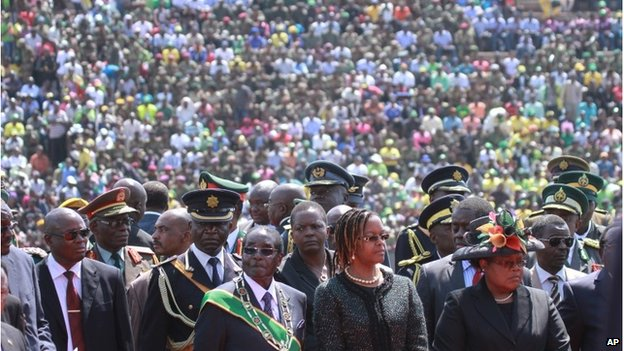 Robert Mugabe ( centre left) with his wife Grace and others attending the commemoration day