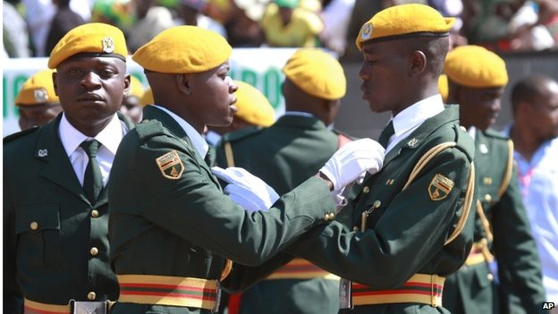 Zimbabwean soldiers adjust their ties at the Commemoration of Heroes' Day in Harare