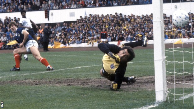 Mark McGhee (left) beats Peter Shilton to open the scoring in a 1-1 draw at Hampden in 1984