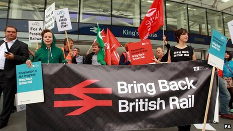 Campaigners with a 'bring back British Rail banner' at King's Cross station