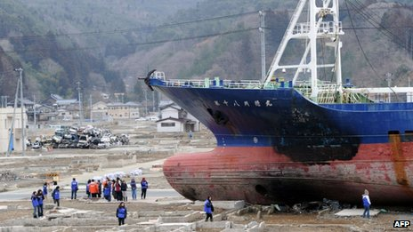 This file picture taken on 8 March 2012 shows 330-ton fishing vessel Kyotoku Maru No. 18 sitting on the ground at Kesennuma in Miyagi prefecture, northern Japan