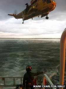Diver rescued off Whitley Bay by Tynemouth RNLI lifeboat and RAF Sea King rescue helicopter from RAF Boulmer