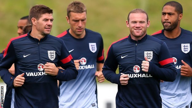 England duo Steven Gerrard (left) and Wayne Rooney (second right)
