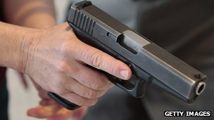 A man holds a pistol at a Utah concealed carry permit class in a December 2012 file photo