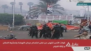 A screen grab from Egyptian state TV shows police forces in Rabaa al-Adawiya camp on 14 August 2013