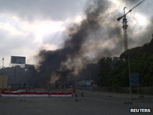 Plumes of smoke rise from Rabaa al-Adawiya camp on 14 August 2013