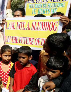 Children protest, holding a poster saying: I am not a slumdog, I am the future of India