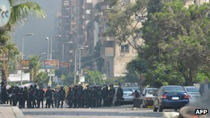Egyptian riot police gather in a street leading to Rabaa al-Adawiya camp on 14 August 2013