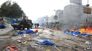 Debris and destruction left in the streets after police storm a pro-Morsi sit-in at Rabaa al-Adawiya on 14 August 2013