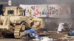 Bulldozers move in to destroy the protest camp near Cairo's Rabaa al-Adawiya mosque on 14 August 2013