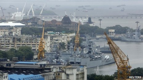 An elevated view shows the Indian Navy ships docked at the naval dockyard in Mumbai August 14, 2013