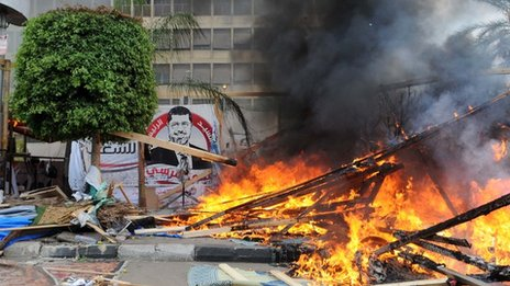 A fire rages after security forces cleared a pro-Morsi protest camp in Nahda Square