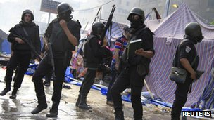 Riot police clear the protest camp at Rabaa al-Adawiya square on 14 August 2013