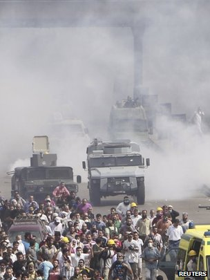 Riot police fire tear gas at members of the Muslim Brotherhood and supporters of deposed Egyptian president Mohamed Morsi around Nahda Square on 14 August 2013