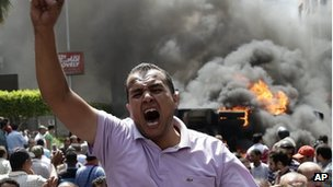Supporters of Egypt's ousted president Mohammed Morsi clash with Egyptian security forces in Cairo's Mohandessin neighborhood
