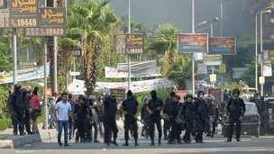 Riot police line up in the street near Cairo's Rabaa al-Adawiya mosque