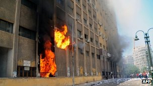 "Supporters of the Muslim Brotherhood and Egypt""s ousted president Mohamed Morsi storm and set fire to a local council building"