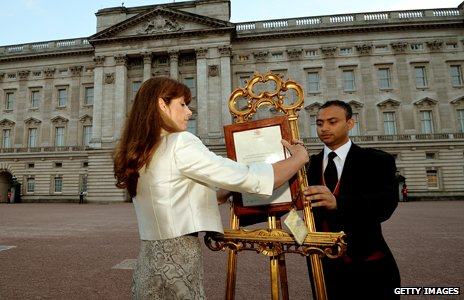 Badar Azim with the Royal press secretary in front of Buckingham Palace