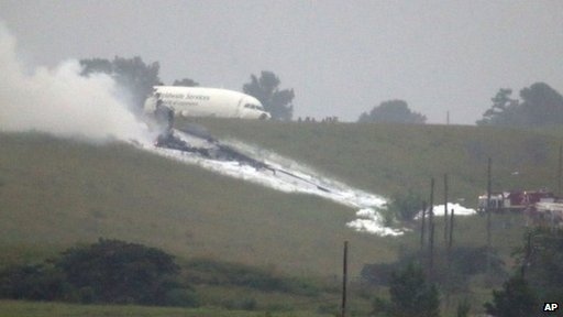 A UPS cargo plane after it crashed near Birmingham-Shuttlesworth International Airport in Birmingham, Alabama, on 14 August 2013