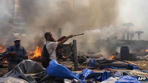 A Muslim Brotherhood supporter fires fireworks towards police during clashes in Cairo on 14 August 2013