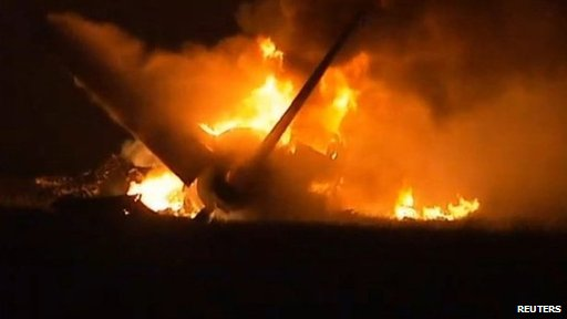 A UPS cargo plane after it crashed near Birmingham-Shuttlesworth International Airport in Birmingham, Alabama, on 14 August 2013 (Courtesy of TV station Alabama's 13)