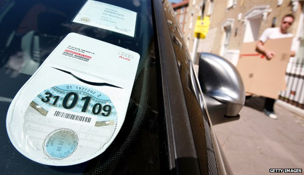 Car tax disc displayed in windscreen