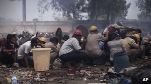 Supporters of ousted Egyptian President Mohammed Morsi take cover from security force fire in Cairo, Egypt on 14 August 2013