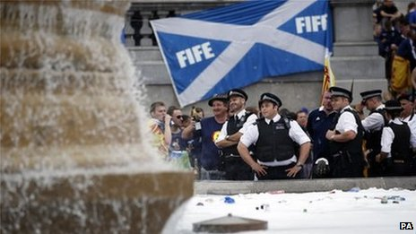 Police look on as Scottish football fans gather in Trafalgar Square