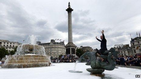 Scottish football fans gather in Trafalgar Square,