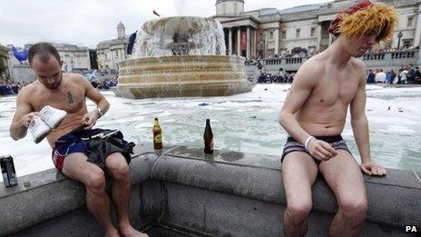 Scottish football fans gather in Trafalgar Square, London