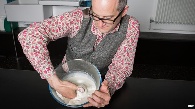Mark Miodownik mixing cornflour and water together to make a smooth non-Newtonian liquid