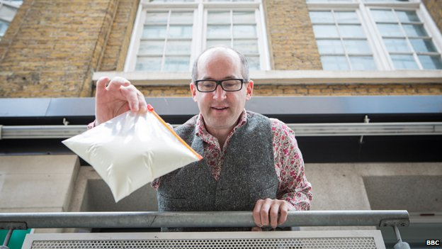 Mark Miodownik gets ready to drop a bag of non-Newtonian cornflour slime containing an uncooked egg