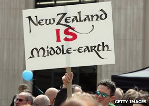 Man holding placard that says: New Zealand IS Middle-earth