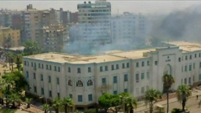 Smoke rises from a building in Suez