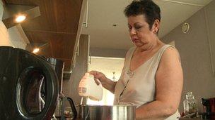 Maureen Wachtels in her kitchen in her Rotterdam apartment
