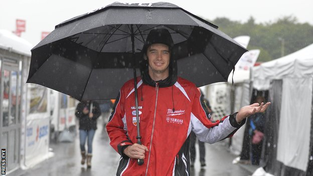 Road racer Conor Cummins takes shelter from the rain after the Dundrod 150 had to be abandoned