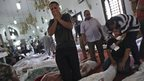 Men grieve over bodies on the floor of Cairo's Eman mosque, 15 August