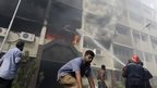Firefighters tackle a blaze in the Giza governorate building, Cairo, 15 August