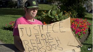 A demonstrator outside provincial court in Halifax, Nova Scotia, on 15 August 2013