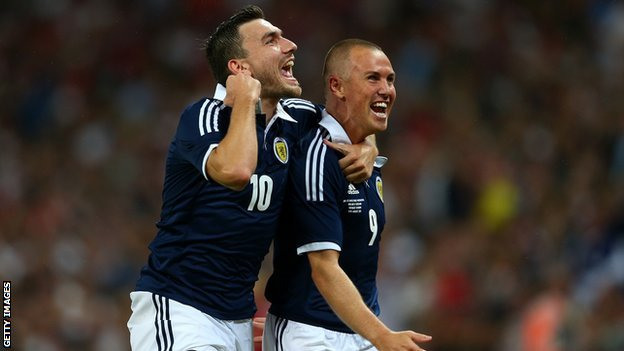 Robert Snodgras and Kenny Miller celebrate
