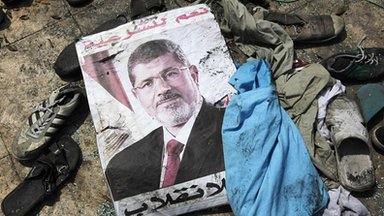 Poster of President Morsi lies on ground in Cairo. 15 Aug 2013